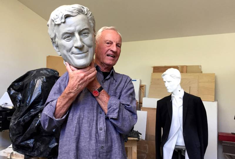 Sculptor Bruce Wolfe poses with the plaster cast of Tony Bennett's head. To Wolfe's right is a model for a bust he's working on of former mayor Gavin Newsom.