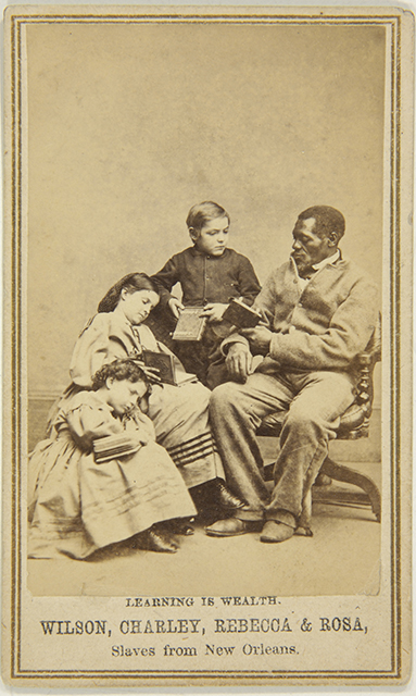 Captioned carte de visite (Learning is Wealth. Wilson, Charley, Rebecca & Rosa, Slaves from New Orleans), c. 1864