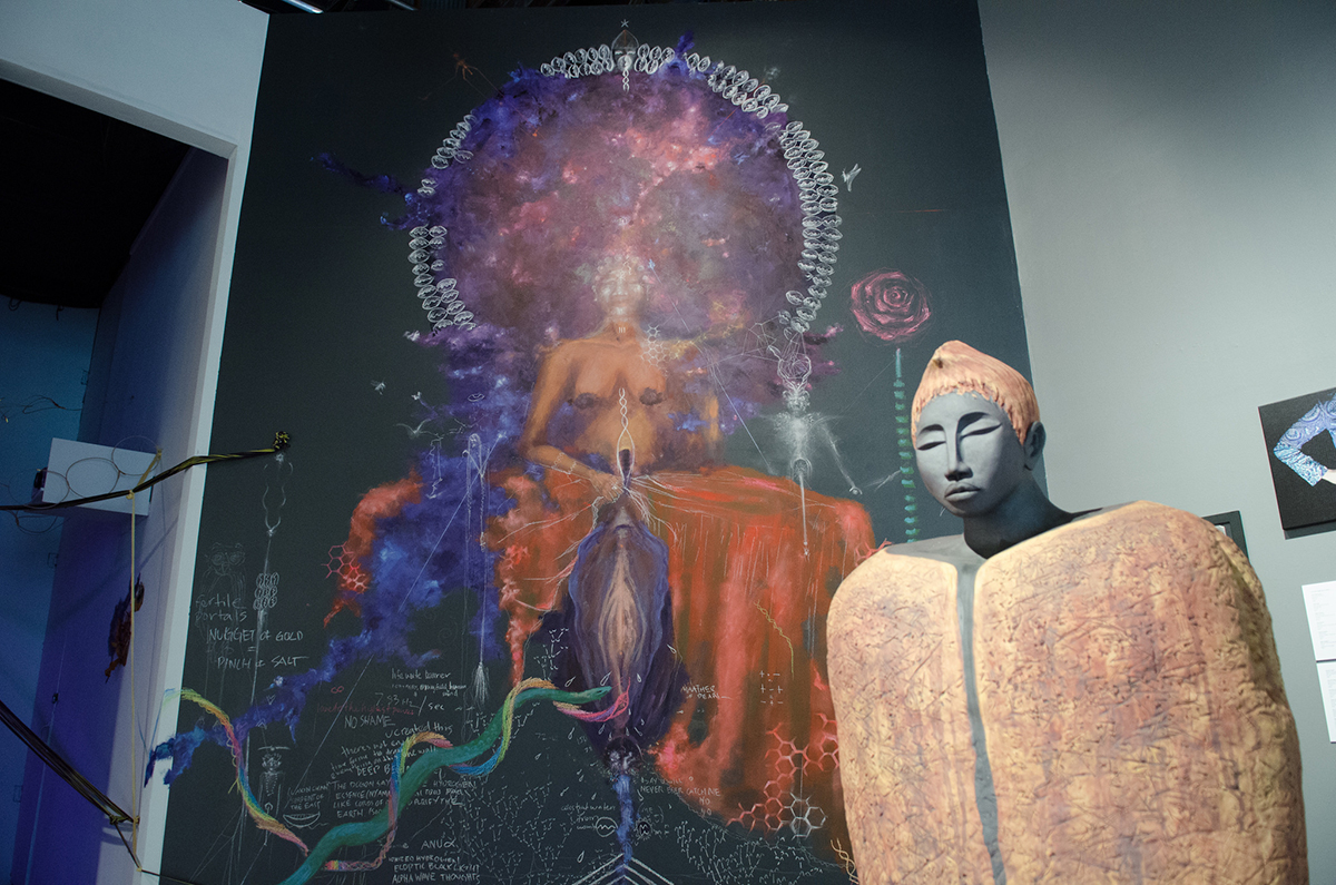 Statue: Amana Brembry Johnson, 'Earth.' Wall: Sage Stargate, 'Ancestral Womb Portal.'