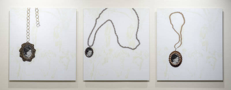 The three faces that appear in Kerry James Marshall's 2002 Heirlooms and Accessories are taken from a 1930 photograph of a double lynching in Marion, Ind. You can hear Marshall talk about this work here.