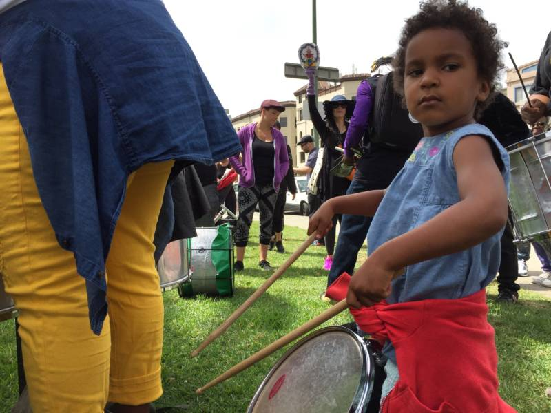 One of many kids who drummed along with Aaron Davis near Lake Merritt on Saturday