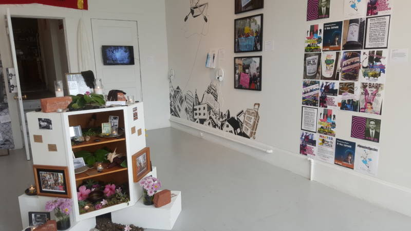 A variety of art takes over the gallery as well as the kitchen and roof of the house.
