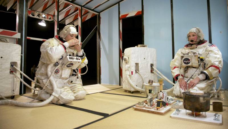 The astronauts perform a tea ceremony on Europa in Tom Sachs' 'Space Program: Europa' at YBCA.