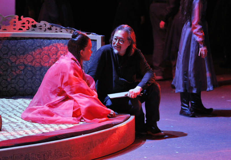 Yiji Shi in costume as Bao Yu with director Stan Lai as they rehearse for world premiere of 'Dream of the Red Chamber' at San Francisco Opera