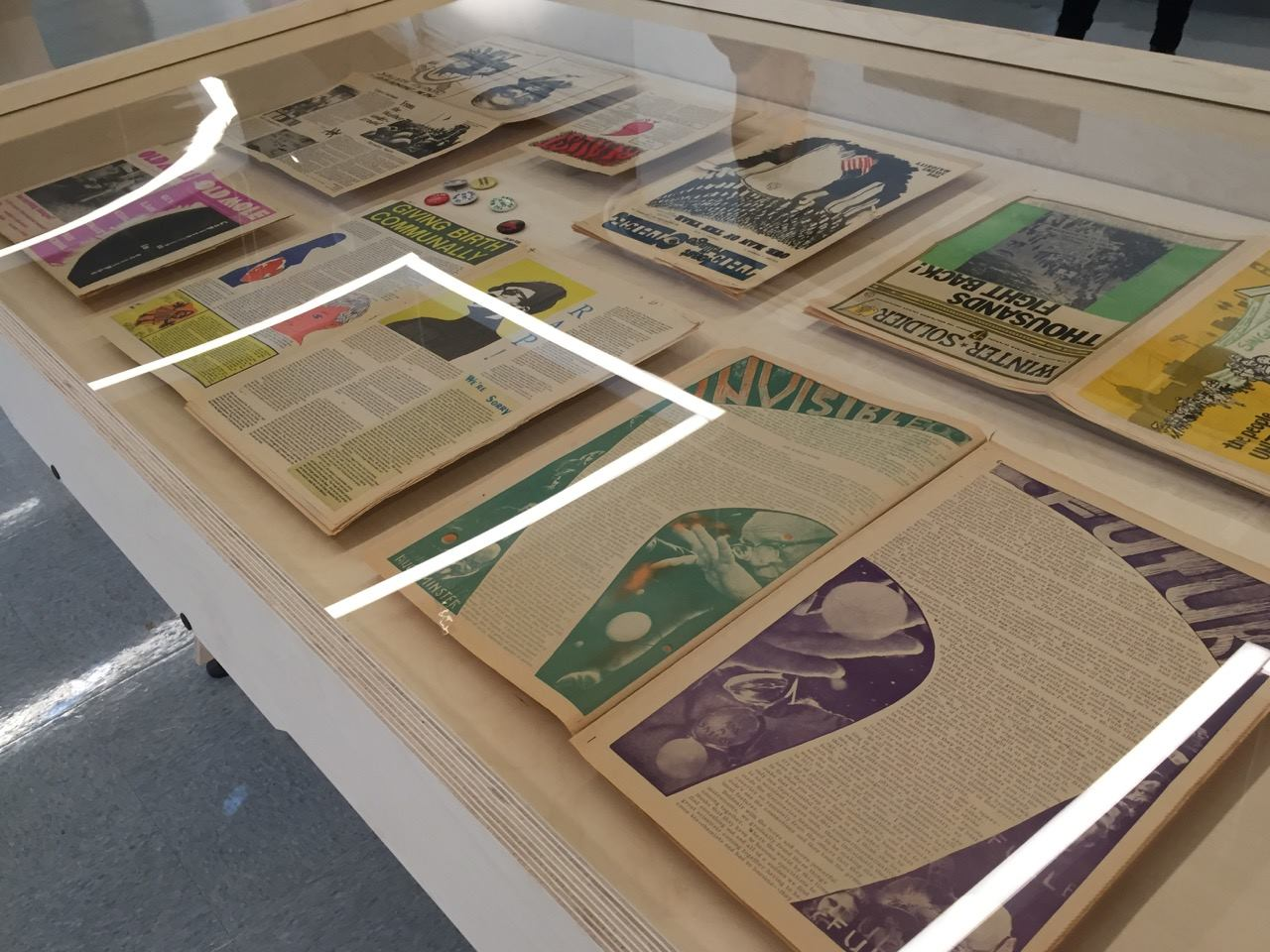 Counterculture newspapers on display as part of the Revolution Times exhibit.