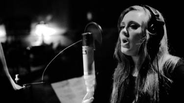 Adele recording a vocal track