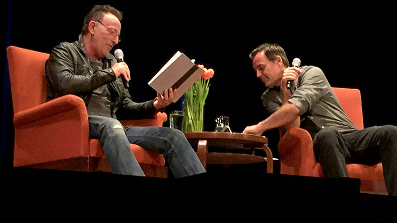Bruce Springsteen reads from 'Born to Run' with interviewer Dan Stone at a City Arts & Lectures appearance at the Nourse Theater in San Francisco, Oct. 5, 2016.