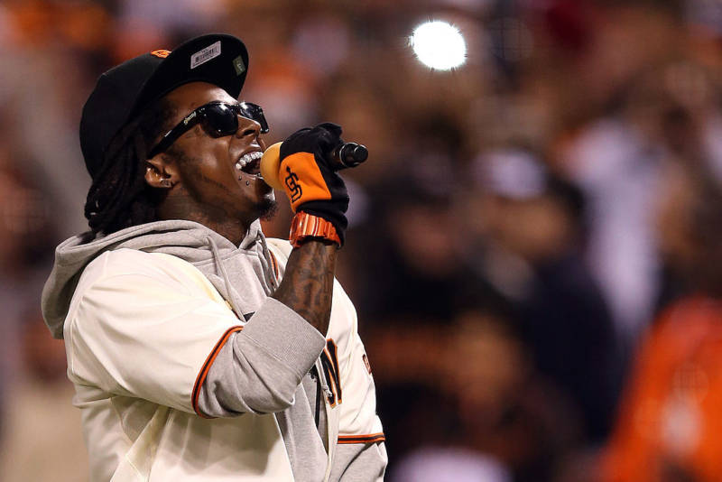 Lil Wayne sings 'Take Me Out to the Ball Game' during the seventh inning of Game Six of the 2012 NLCS Championship in San Francisco.