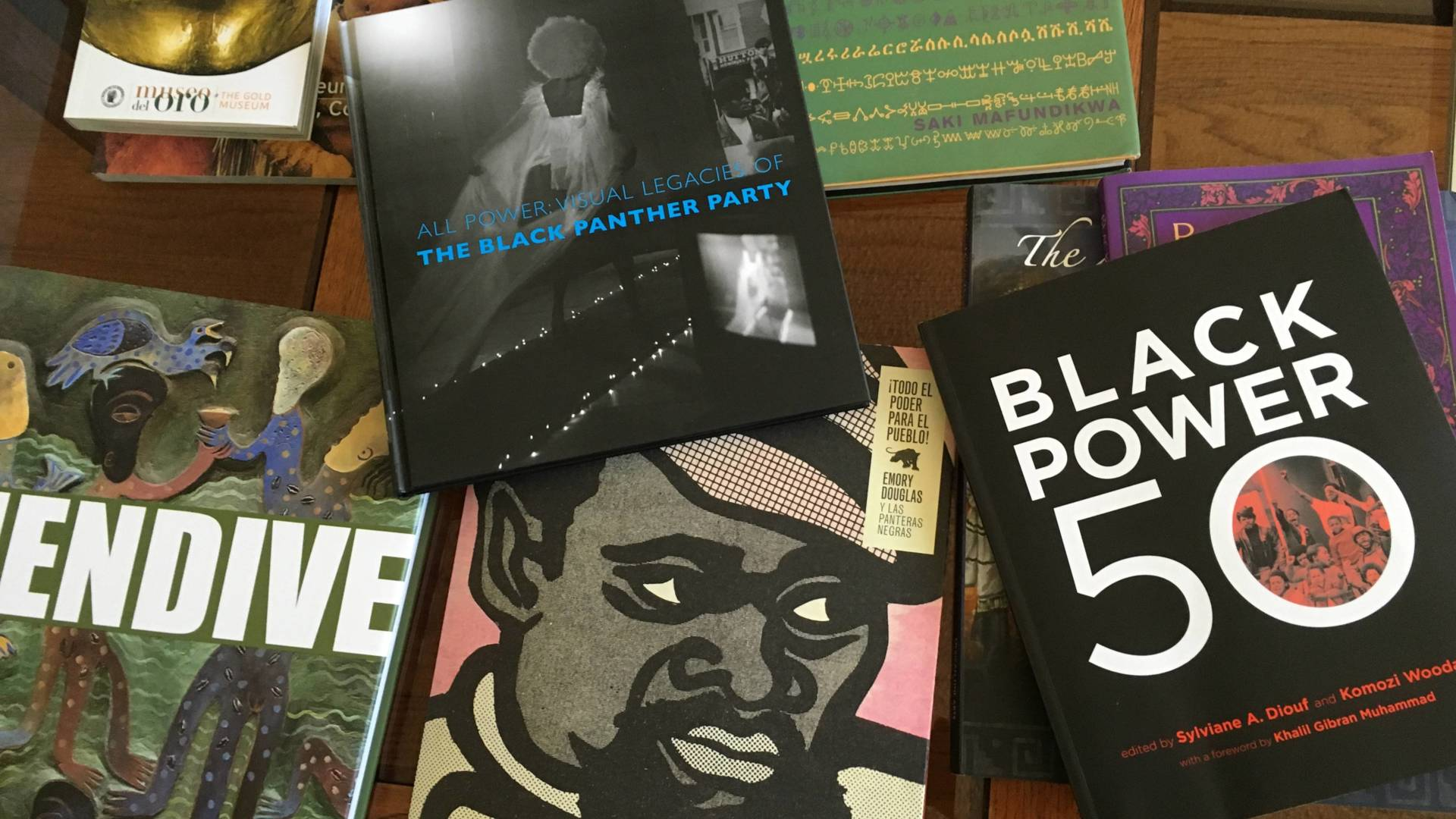A selection of books about the Black Panther Party for Self Defense adorn the coffee table in the San Francisco apartment of Panther Minister of Culture Emory Douglas.