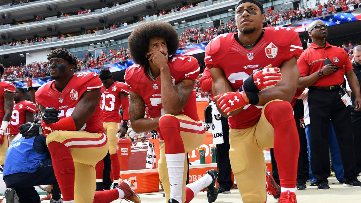 (L-R) Eli Harold #58, Colin Kaepernick #7 and Eric Reid #35 of the San Francisco 49ers kneel on the sideline during the anthem prior to the game against the Dallas Cowboys at Levi's Stadium on October 2, 2016 in Santa Clara, California.