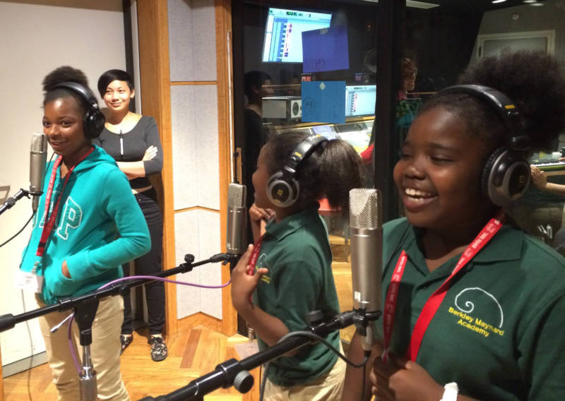 Students try out vocal mics during a class at WAM