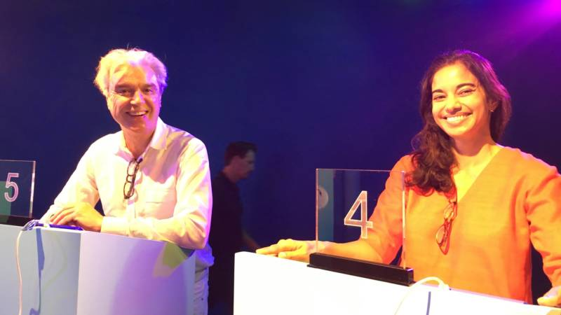 "David Byrne and Mala Gaonkar in the TV game show room. Byrne says the process of participating in these quasi-scientific studies ""really does change how you think about things. How you think about what we are and how we react and how make decisions and how we are in the world."""