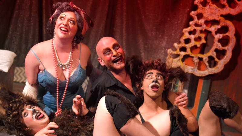(L to R) Madame Banga (Zelda Koznofski) and Tozzini (David Bicha) share some time with their dog children (Alix Feinsod and Earl Alfred Paus) in the Thrillpeddlers' production of 'Pyramid of Freaks' by Rob Keefe.