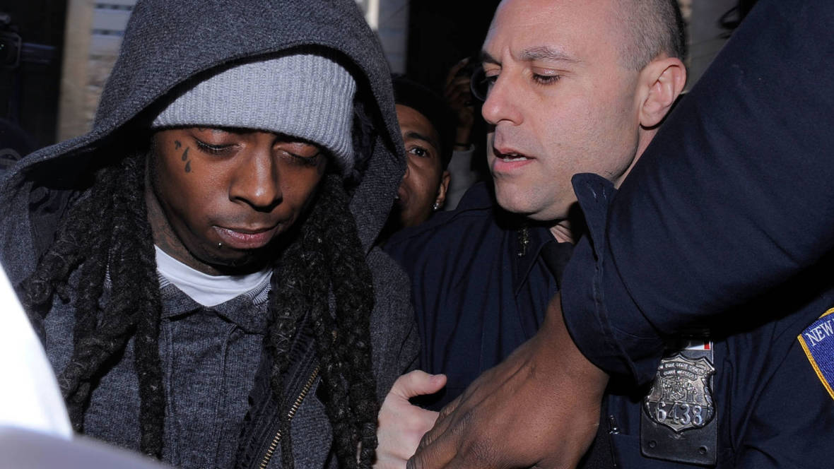 Lil Wayne arrives at New York State Supreme Court to begin serving a 1 year prison sentence for possession of an illegal weapon on March 8, 2010, in New York City.   Jemal Countess/Getty Images