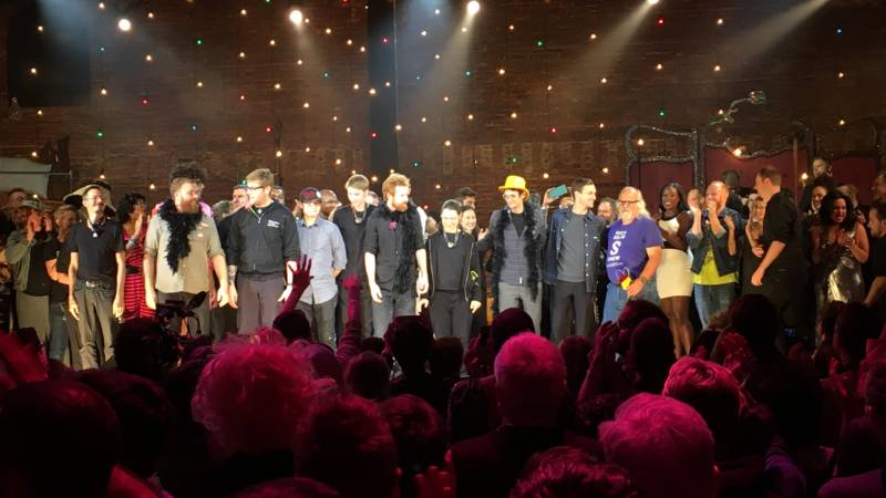 After performing for 24 hours straight, the cast and crew of 'A 24 Decade History of Popular Music' take a bow.