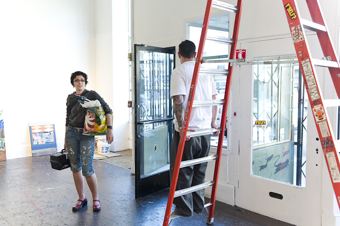 Jessica Hess and Justin Giarla during install of 'It Finds You' at White Walls.