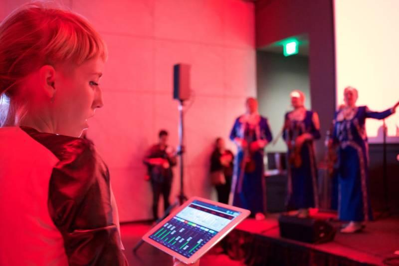 A WAM student runs live sound during a concert