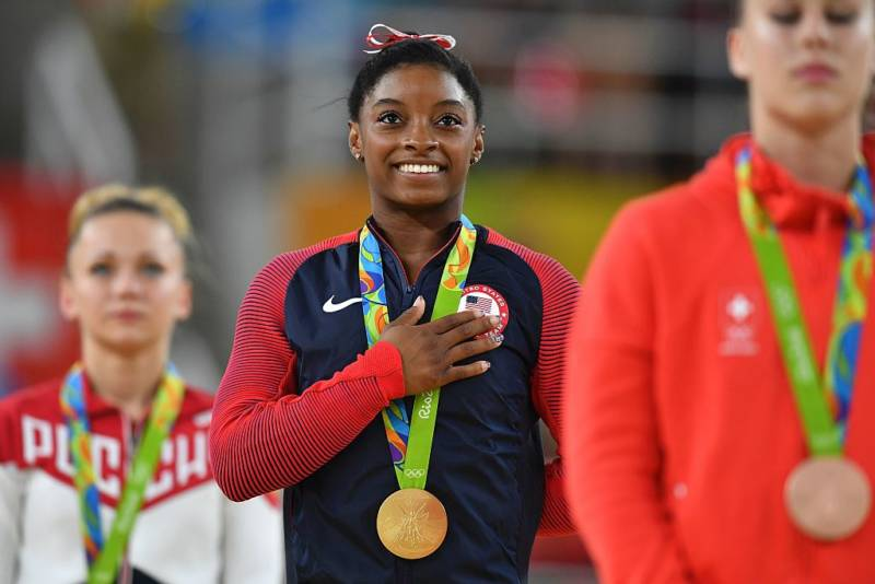 Simone Biles on the podium for the women's vault event final of the Artistic Gymnastics at the Olympic Arena during the Rio 2016 Olympic Games in Rio de Janeiro on August 14, 2016.