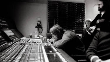 Pink Floyd's Roger Waters at a mixing desk in 1974