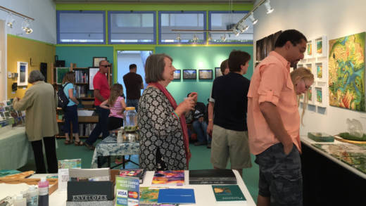 Members of the public take a look at the artwork of Linda Gass at a recent Cubberley Artist Open Studios.