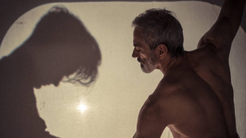 (L to R) The shadow of Young Remy (Colin Creveling) confronts Old Remy (Paul Loper) in 'Rainbow Logic' by Seth Eisen.