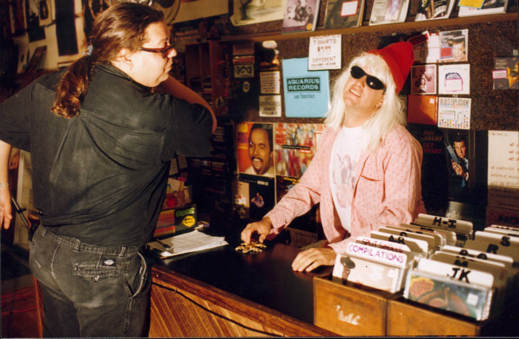 Ray Wilcox and Chris Enright in a scene set at an old Aquarius Records location