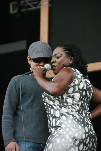 Sharon Jones serenades a fan pulled up from the audience at the 2008 Outside Lands Festival.