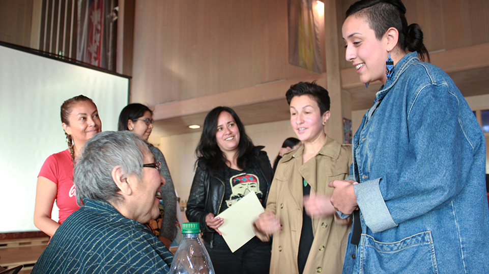 Muralist Yolanda Lopez speaks to festival attendees after her talk.