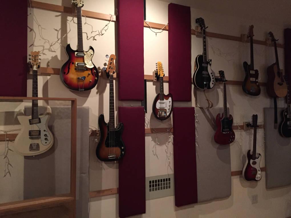 Guitar wall in Decibelle Recording Studio