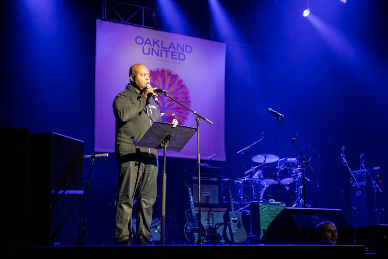 Glynn Washington speaks at the Oakland United benefit at the Fox Theater on Dec. 14, 2016.