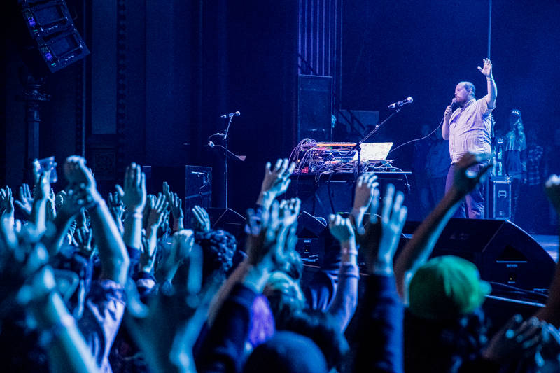 The crowd listens to reverend Dan Deacon at the Oakland United benefit at the Fox Theater on Dec. 14, 2016.