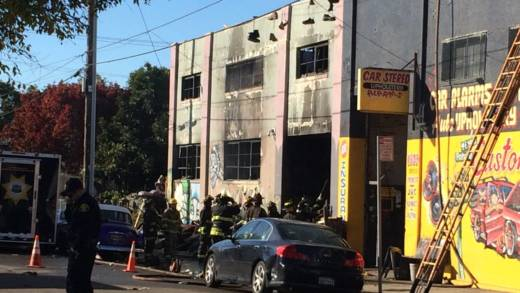 Oakland, California, firefighters inspect a warehouse the day after a fire there killed 9 people on Dec 2.