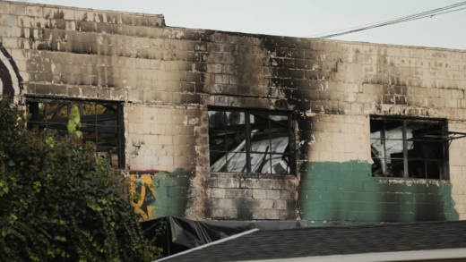The burnt exterior of a warehouse in which a fire claimed the lives of at least thirty-three people is seen on December 4, 2016 in Oakland, California. The fire took place during a musical event late Friday night.