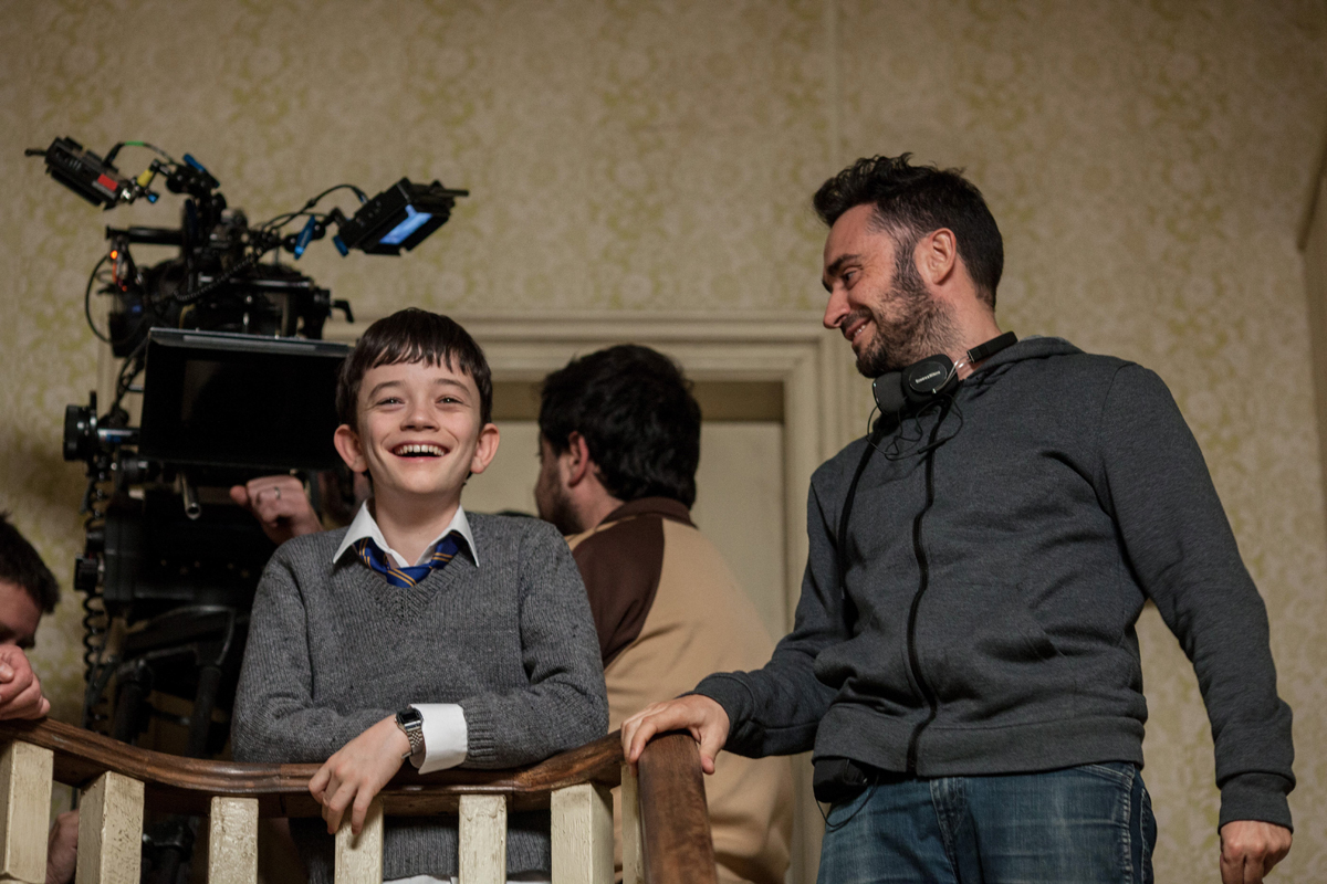 Actor Lewis MacDougall (left) and director J.A. Bayona (right) on the set of 'A Monster Calls.'
