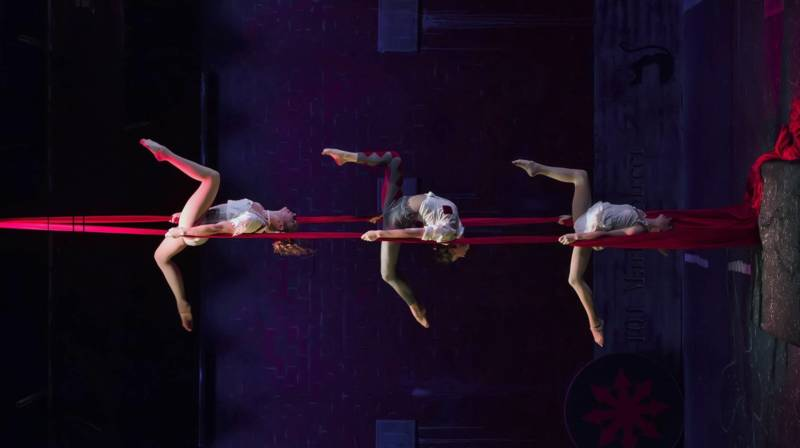 (L to R) TT Robson, Julie Rogers, and Lillian Ferreira hang in unison in Kinetic Art's 'Inversion' directed and conceived by Jaron Hollander.