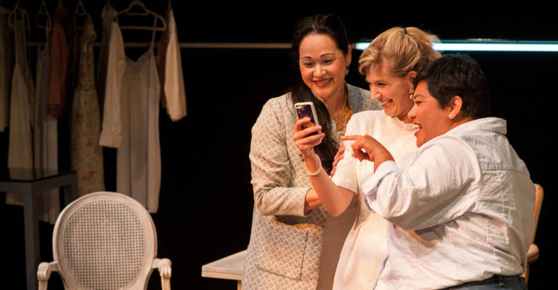 Julia (Karen Offereins), Ana (Sarah Moser), and Mehr (Amy Lizardo) get excited about Ana's second date.