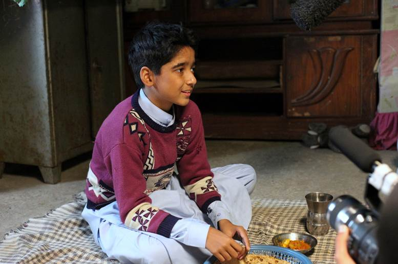 Uzair Ali preparing for a scene in which he's eating dinner with his character's brother