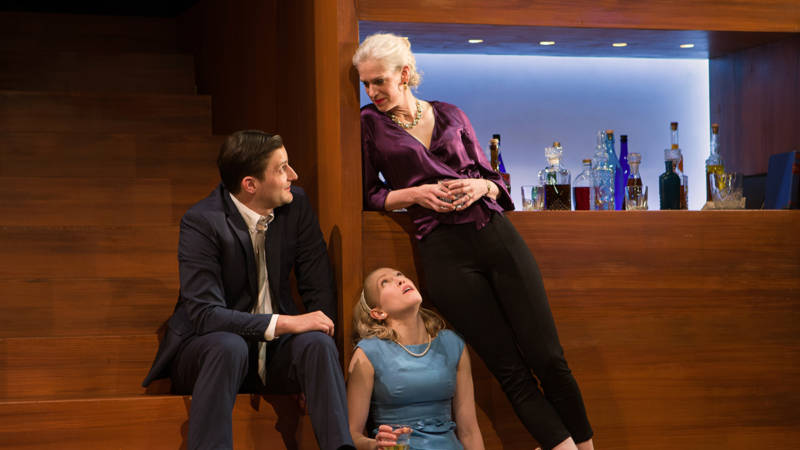(L to R) Nick (Josh Schenell) and Honey (Megan Trout ) get a little lesson from Martha (Beth Wilmurt) on drinking and life in 'Who's Afraid of Virginia Woolf?'