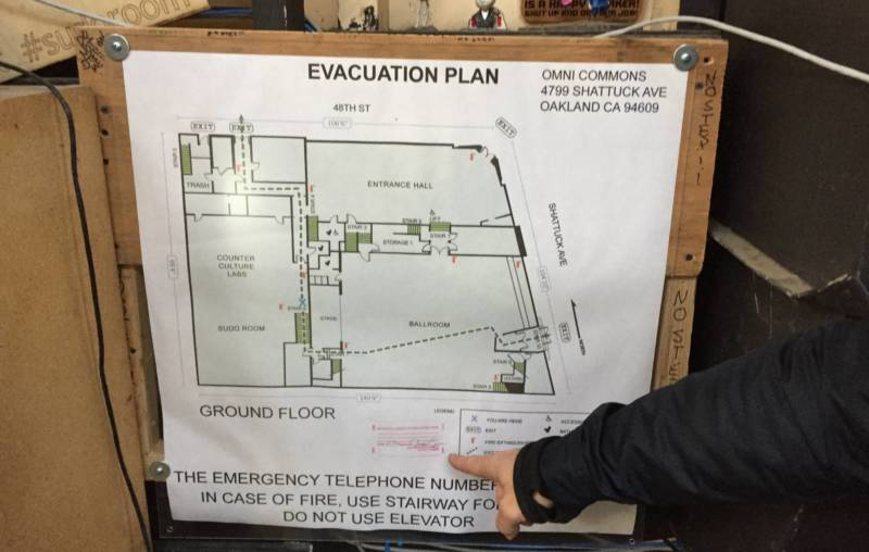 An evacuation map signed by the Oakland Fire Marshall at the Omni Commons