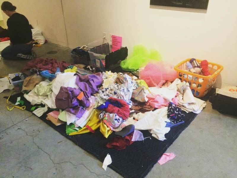 A giant scrap fabric pile, collectively donated by visitors and participants to the Reap What You Sew protest signage workshop at Southern Exposure.