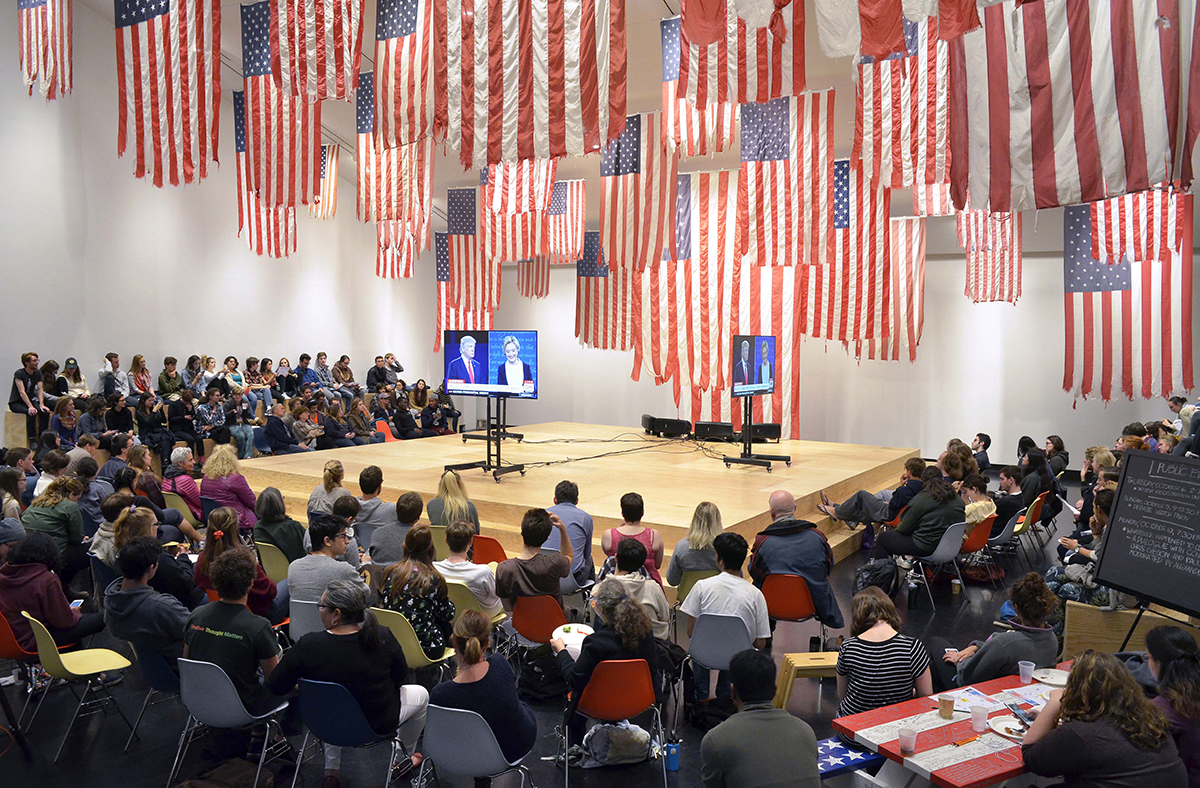 Debate watch party at the Tang under Mel Ziegler's 'Flag Exchange.'
