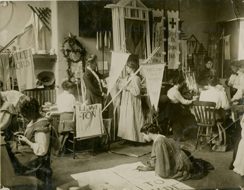 Making banners for a Women's Social & Political Union rally, 1910.