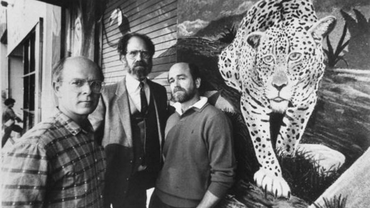 Skin-flick impresarios Artie (R) & Jim Mitchell flanking their attorney Dennis Roberts as they stand next to large wall mural of a leopard at the time of the brothers partnership dispute which later was resolved when Jim killed Artie.