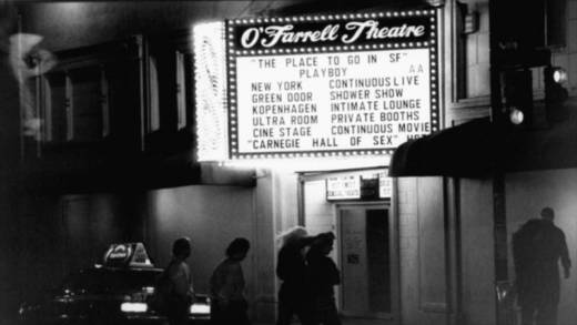 Night view of O'Farrell Theatre marquee listing a continous live shower show, intimate lounge, private booths & continous movie which are featured at this porn palace owned by skin-flick impresarios Jim & Artie Mitchell, several mos. after Artie's death.