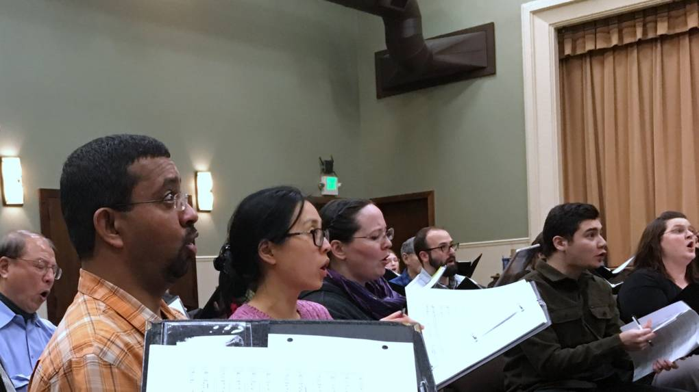 """The Choral Project rehearses Street Requiem at Willow Glen United Methodist Church in San Jose. """"It was such a moving work,"""" says baritone Wilfred Matthews (far left), who's performed the piece before. """"I felt like I could contribute in a little way to spreading the message of hope for the marginalized in our society."""""""