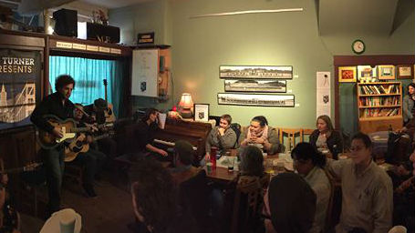 A crowd listens in during a performance at Bazaar Cafe.