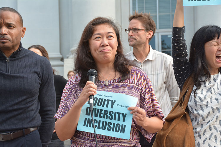 Catherine Ceniza Choy, professor in the Department of Ethnic Studies holds the microphone, professor Stephanie Syjuco on the right.