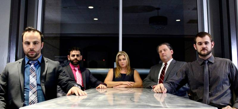 Corporate consultants with a creepy agenda: Pictured, from left: Brock (George Psarras), Sandeep (Sunny Moza), Hannah (Lisa Mallette), Ted (Tom Gough) and Scooter (Max Tachis)