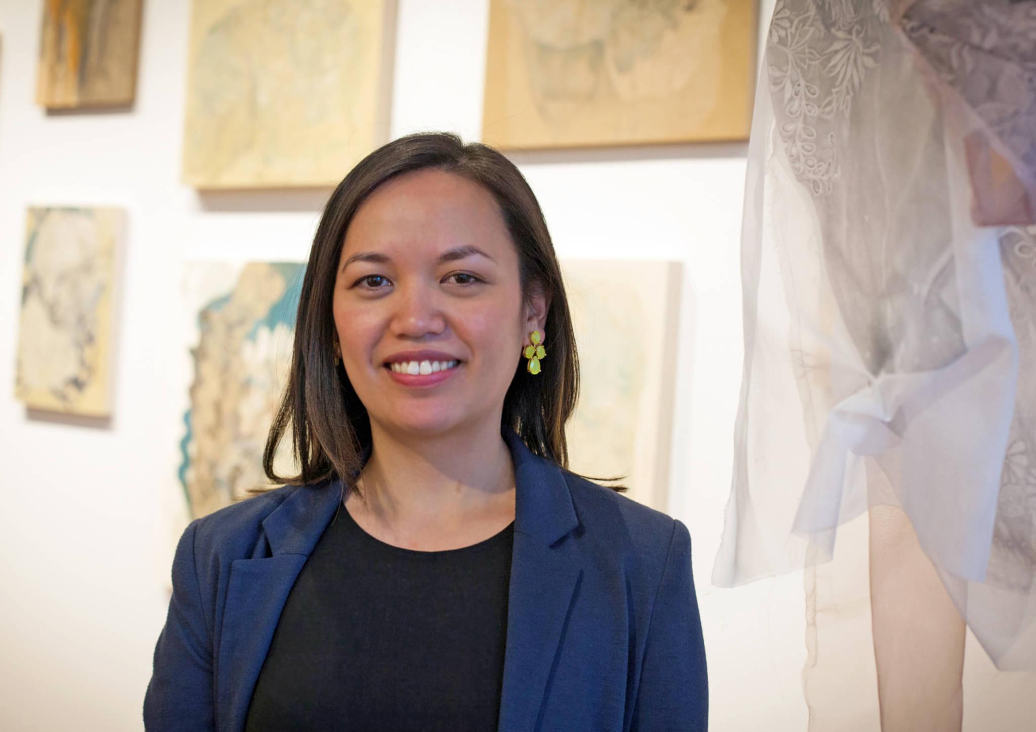 Rea Lynn de Guzman stands in front of her work.