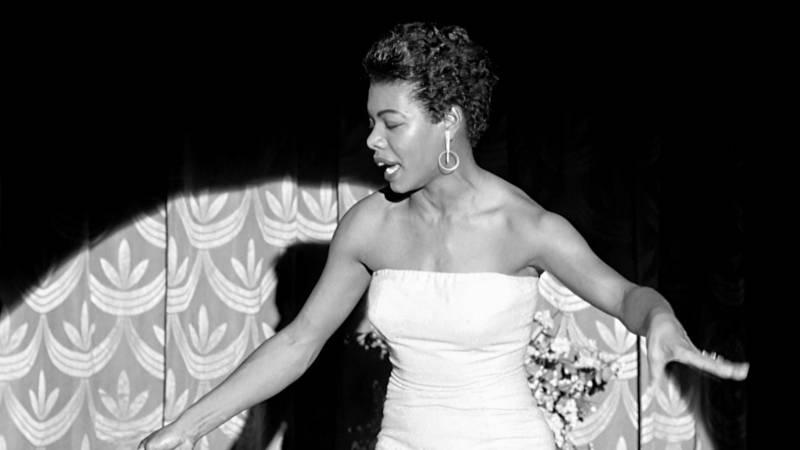 Maya Angelou performing on stage